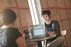 Inside the funky space, Jenn Lim from Delivering Happiness gets prepared for her Fireside Chat and stays productive.