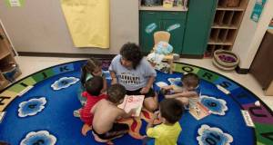 A teacher reads to young children at the Francis Institute for Child and Youth Development at Metropolitan Community College-Penn Valley. Shane Keyser  / The Kansas City Star
